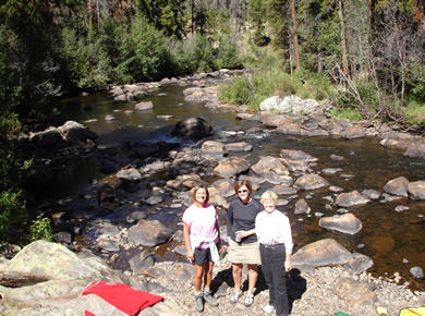 Karen Anne and Sue Weltner by the creek